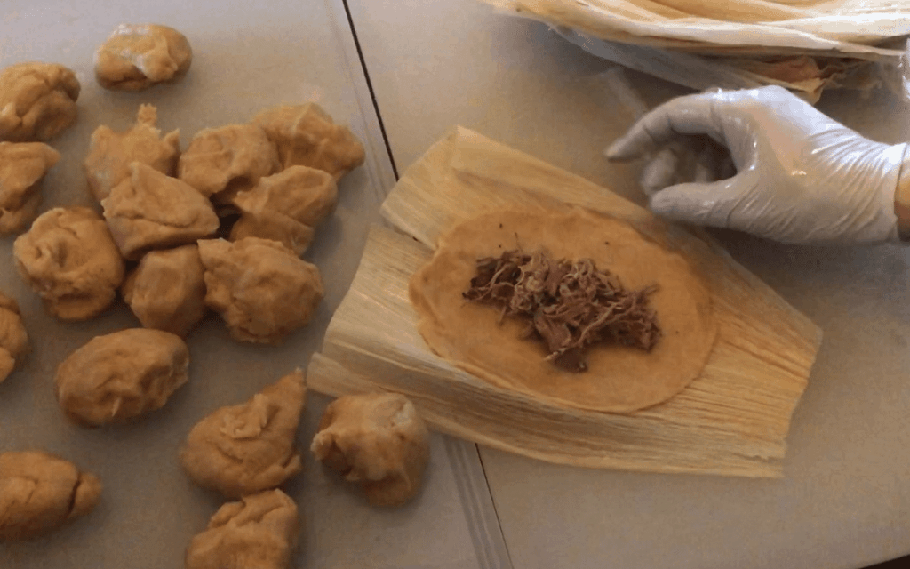 Topping low carb tamales with meat