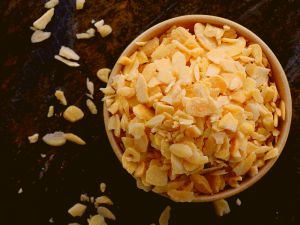 Press cookies in chopped almonds