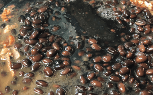 Adding black soybeans to a pan