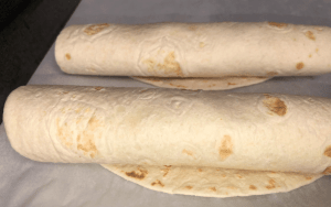 Rolled flautas ready to brush on butter