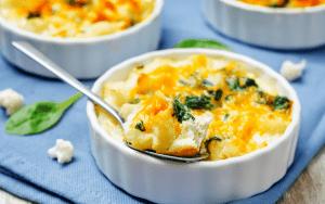 Served low Carb Cauliflower cheese bake in ramekins