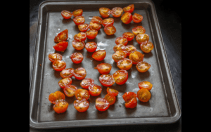 Sliced cherry tomatoes ready to broil