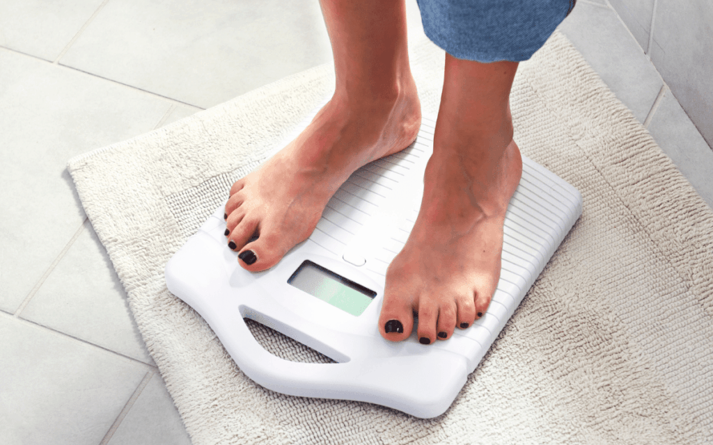 Menopusause and low carb diet - woman ona  scale.