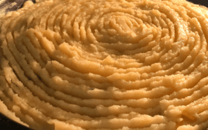 Spread mash on top of pie